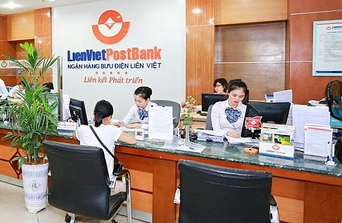 law on dual roles rearranges top bank personnel