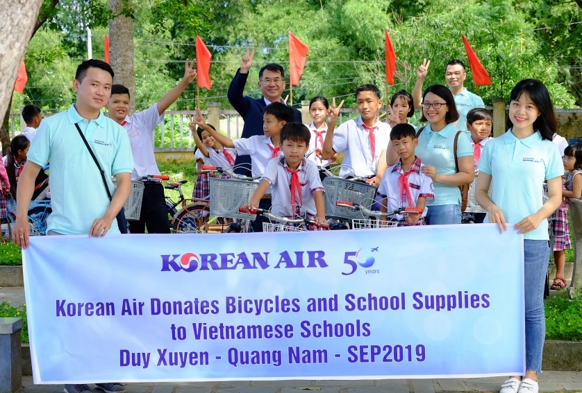 korean air donates bicycles and balls to central vietnamese schools