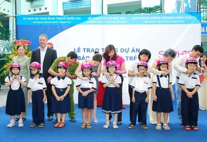 sophie paris vietnam donates helmets to vietnamese children
