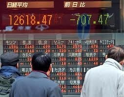 asian markets slip after us data wall st loss
