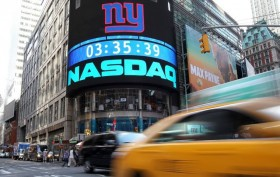 Nasdaq ends over 7,000 for first time, S&P 500 also hits new record