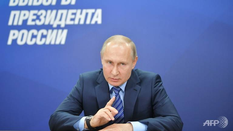 putin promises minimum wage hike ahead of election
