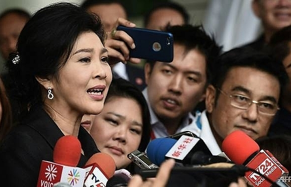 hong kong filings show thailands yingluck has cambodian passport