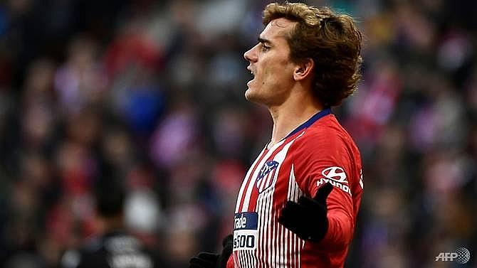 atletico crash out of copa del rey but real sevilla sneak through