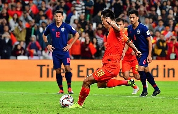 china roar back from behind to reach asian cup quarter finals