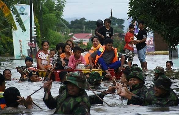 indonesia flood landslide death toll rises to 26