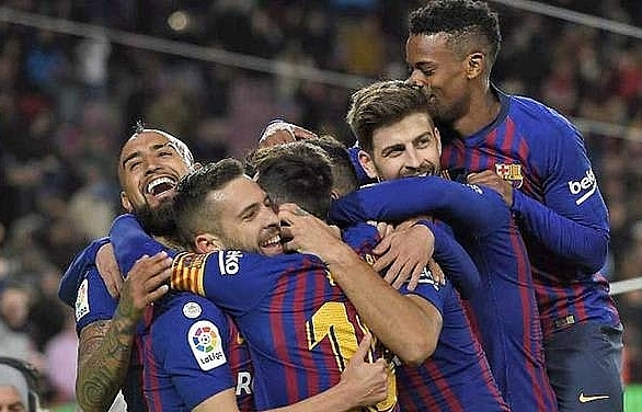 barcelona hit sevilla for six to book semi final place