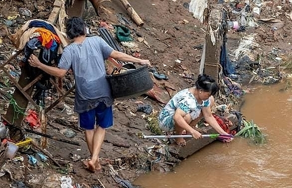 at least 60 dead and thousands in shelters as floods hit indonesia