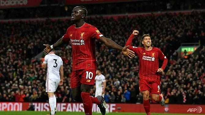 liverpool march towards history as top four race heats up