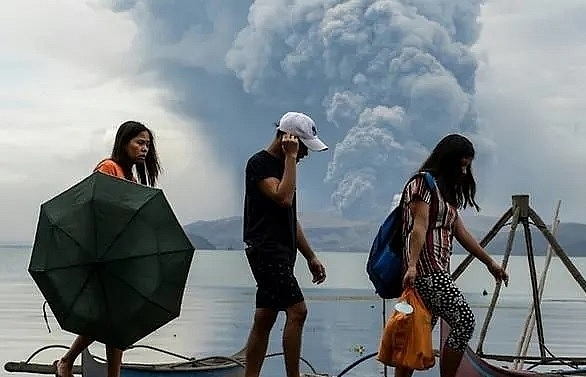thousands face uncertainty as philippine volcano spews lava