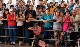 Families, eager to see their beloved's return, blamed for overloading Vietnam's busiest airport