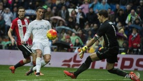 Ronaldo hits double in Madrid win, Neville records first win