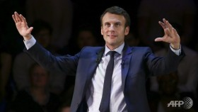 French candidate Macron urges expats to return home