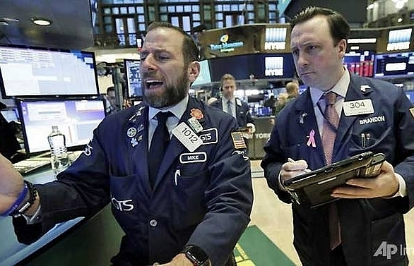 wall street plunges as dow erases 2018s gains