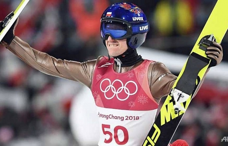 stoch retains ski jump title at the death