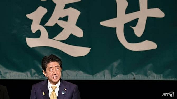 japans abe strikes dovish tone on russia at kuril islands rally