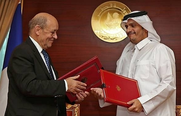 france agrees strategic pact with qatar