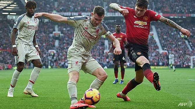 liverpool go top after stalemate at injury hit united