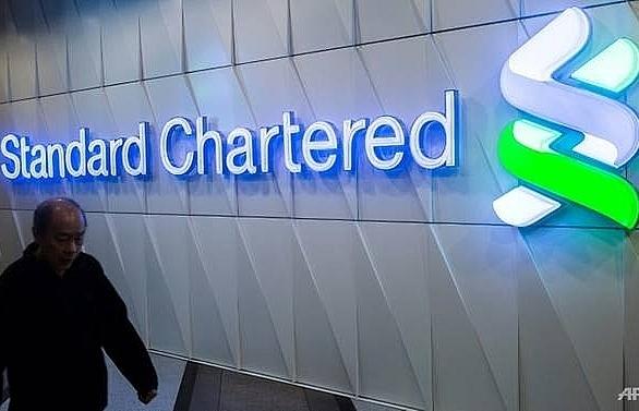 standard chartereds 2018 profits rise despite setting aside cash for fines