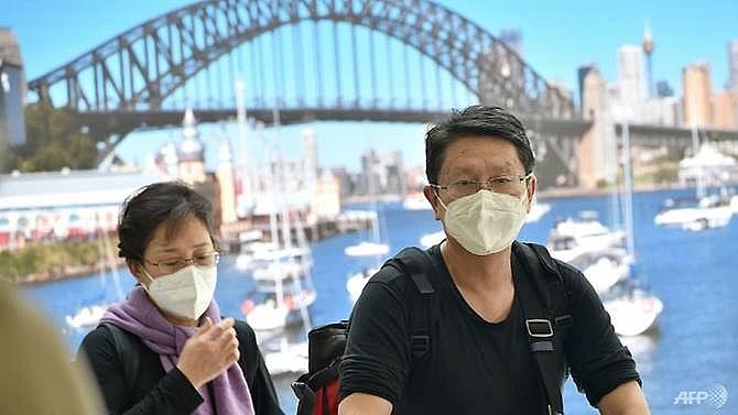 australia warns covid 19 pandemic now upon us