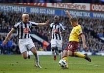 arsenal lose ground despite battling draw