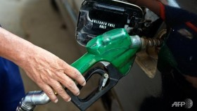Oil dives on soaring dollar after US jobs report