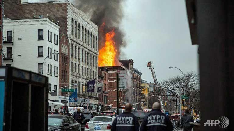 12 hurt in New York building collapse, blaze