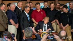 Trump signs order to roll back Obama's climate measures