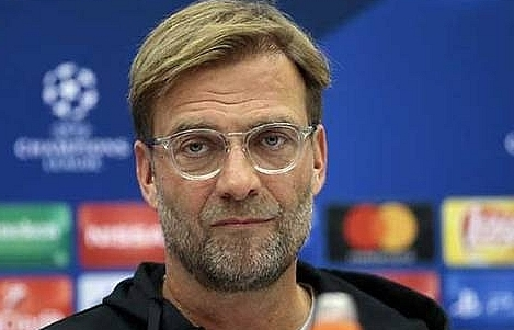 liverpool vow to spend after posting profit