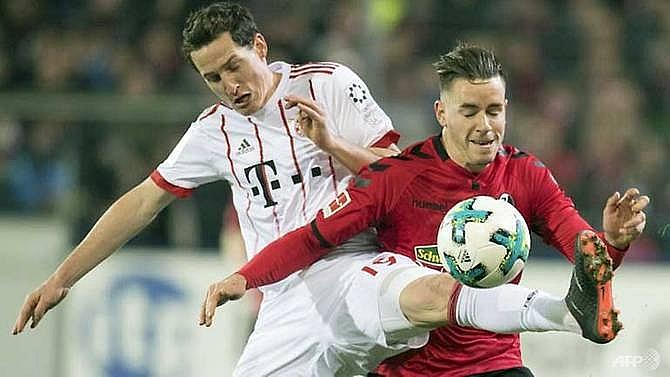 four goal bayern open 20 point lead in bundesliga