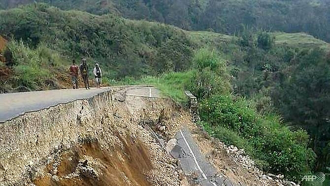 papua new guinea quake leaves 67 dead as aftershocks rock homes red cross