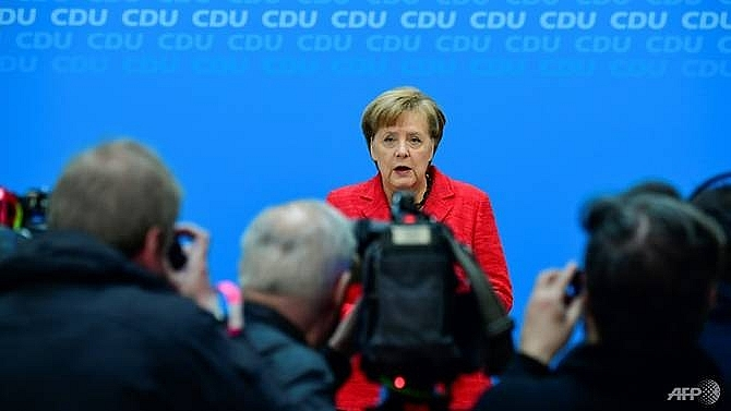 merkel vows swift return to government work to boost europe