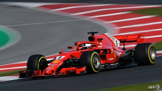 vettel quickest as f1 testing resumes in spain