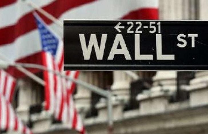 nasdaq ends at record high dow falls on trade war worries