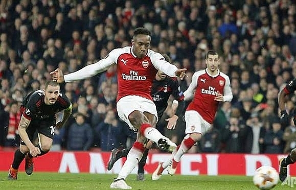 welbecks double helps arsenal past milan dortmund dumped out