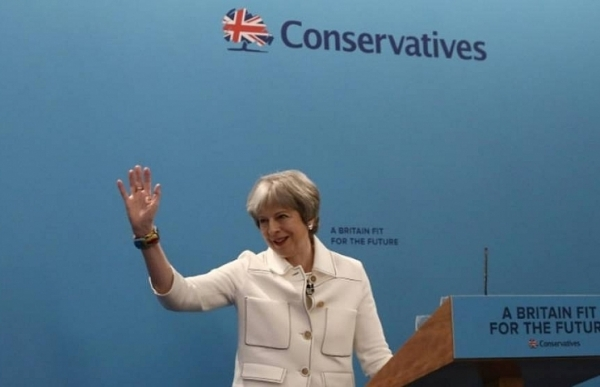 british pm may rallies party with warning to russia