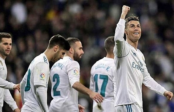 messi takes barcelona 11 points clear ronaldo hits four