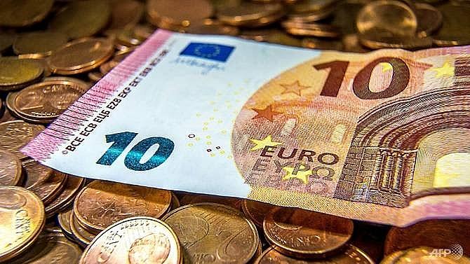 eurozone delays greece debt relief over reforms