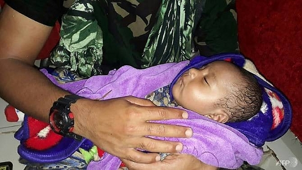baby reunited with dad as indonesia flood death toll hits 77
