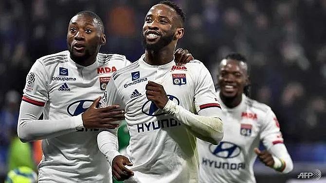 lyon take derby honours to boost european hopes