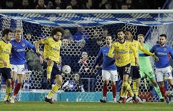 arsenal reach fa cup quarter finals to ease euro woe