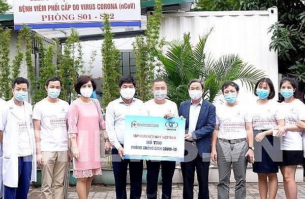 garment firm donates hundreds of antibacterial shirts to hanoi hospital