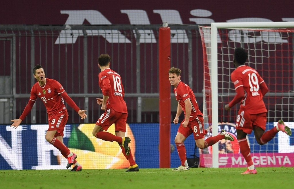 lewandowski hat trick tops haaland double as bayern beat dortmund