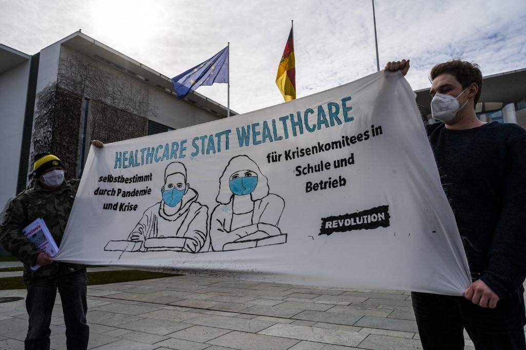 germany orders tough easter shutdown as eu astrazeneca row simmers
