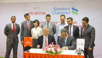 prudential vietnam and standard chartered vietnam sign partnership agreement