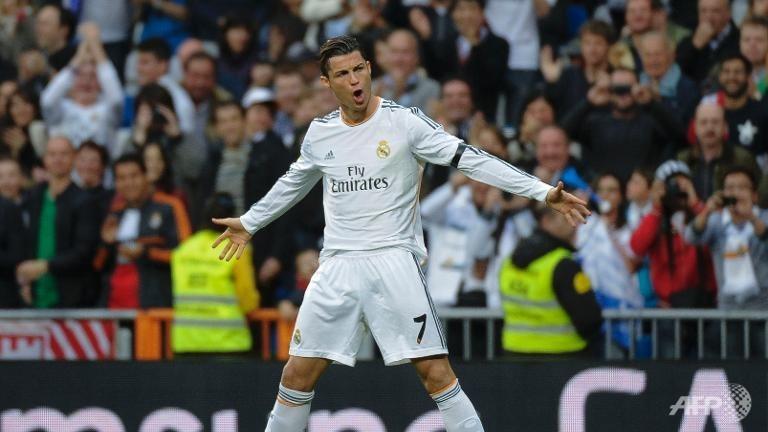 Classy Ronaldo double eases Madrid past Osasuna