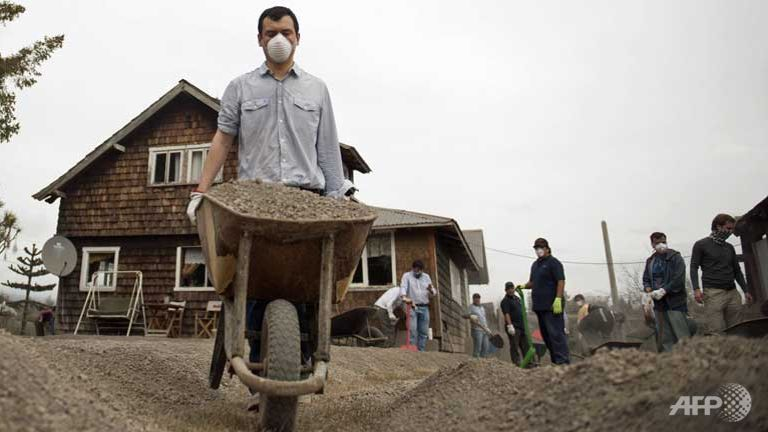 People clean the ash from the Calbuco volcano around their home at La  Ensenada 28801fd95d05