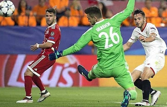 thiago grabs winner as bayern come back to beat sevilla