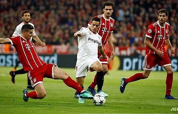 bayern toil but overcome sevilla to reach semi finals
