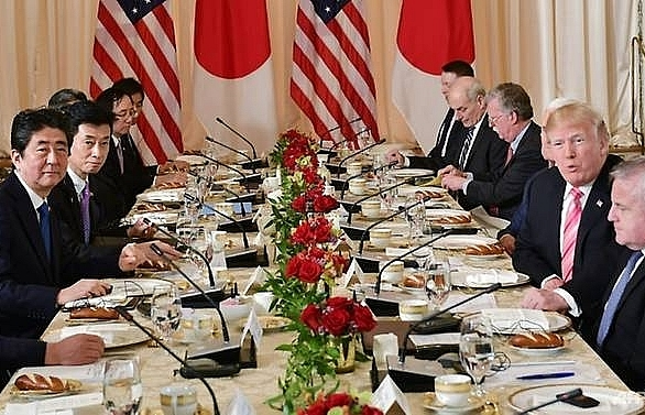 trump issues public challenge to abe on trade